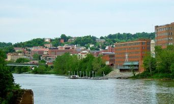 Morgantown from across the Monongahela River. From en.wikipedia.org/wiki/File:City_of_Morgantown_from_the_west_side_of_the_Monongahela_River,_May_2012.jpg.